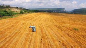 Tractor With Trailer Moving On Harvested Field stock video