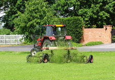 Tractor with trailer Mowing grass Stock Photo