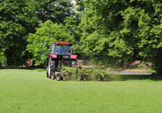 Tractor with trailer Mowing grass Stock Image
