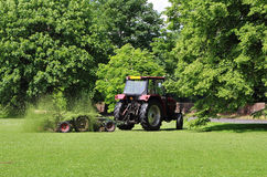 Tractor with trailer Mowing grass Stock Photos