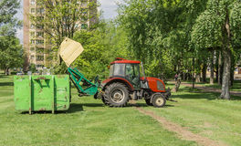Tractor with trailer mowing grass Stock Photography