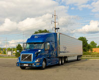 A tractor trailer in a parking lot Royalty Free Stock Images