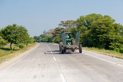 Tractor and trailer on road Stock Photo