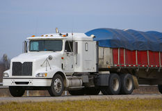 Tractor Trailer with Tarp. Semi with Tarp over trailer covering Pay load Royalty Free Stock Images