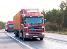 Tractor trailer trucks (lorry) caravan convoy line Royalty Free Stock Image