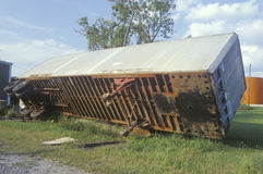 A tractor trailer turned on its side during Hurricane Andrew Royalty Free Stock Photos