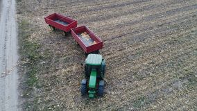 Tractor and trailers. Shooting by Drone in the fields near the city of Novi Sad, as a support for combines, for the transport of grain Royalty Free Stock Photography