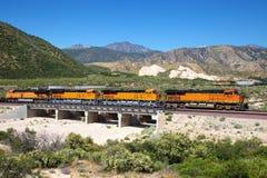 Tractor train passing through the bridge Stock Photo