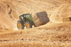 Tractor transport straw bales Royalty Free Stock Images