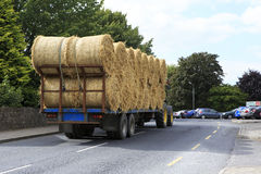 Tractor transporting straw bales in irish Royalty Free Stock Photography