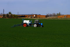 The tractor treats crops from parasites and insects Stock Photography