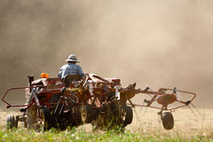 Tractor turning the hay. Royalty Free Stock Photos