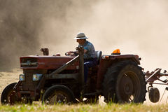 A tractor turning the hay royalty free stock photo
