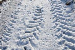 Tractor Tynes in de sneeuw royalty-vrije stock afbeeldingen
