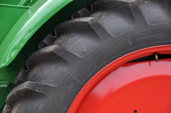 Tractor tyre detail. Closeup with red rim Stock Photography