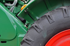 Tractor tyre detail. Closeup with red rim Royalty Free Stock Image