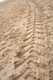 Tractor Tyre print. On beach stock photography