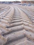 Tractor tyre tracks on the beach Stock Photos