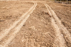 Tractor tyre tracks on the ground Royalty Free Stock Images