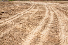 Tractor tyre tracks on the ground Stock Photo