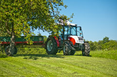 Tractor under apple tree Stock Image
