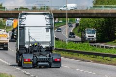 Tractor unit lorry truck on uk motorway in fast motion.  royalty free stock photo