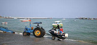 This tractor is used for launching boats off the beach. Stock Photos