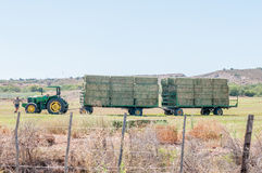 Tractor and wagon with bales of hay Royalty Free Stock Photos