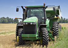 Tractor with Wagon in Field. A tractor in the field with a harvest wagon attached. Farm located in Ohio stock photos