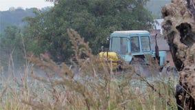 Tractor watering field stock video