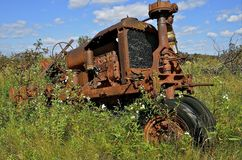 Tractor in the weeds Royalty Free Stock Photos