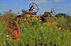 Tractor in the weeds Royalty Free Stock Images