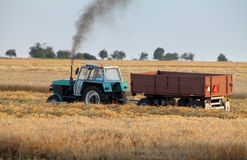 Tractor on wheat field Royalty Free Stock Photography