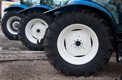 Tractor wheel. Three new blue tractor, white wheel Royalty Free Stock Photos