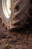 Tractor wheel. A tractor wheel with a muddy tire Royalty Free Stock Images