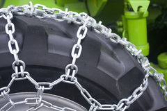 Tractor wheel. Detail of agricultural tractor wheel with chains Stock Image
