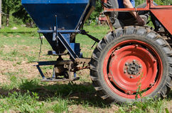 Tractor wheel seeder equipment sow buckwheat seeds Royalty Free Stock Images