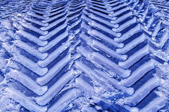 Tractor wheel tracks in the snow. Stock Photo
