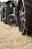 Tractor Wheels. Old tractor wheels on a sunburned field Stock Photography