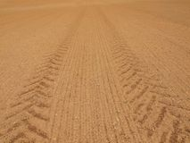 Tractor wheels trails in extremely dry dusty clay Stock Photography
