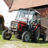 Tractor with wood Royalty Free Stock Image