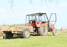 Tractor with wood. An old red tractor vehicle with a cargo of wood Stock Images