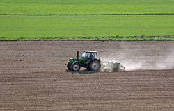 Tractor in Work. This image shows a tractor in work stock photography