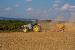 Tractor at work on farm stock photo