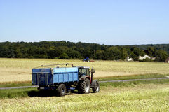 Tractor with work in a field Royalty Free Stock Image
