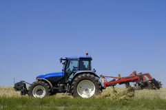 Tractor with work in a field Stock Images