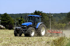 Tractor with work in a field Royalty Free Stock Photos