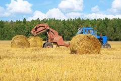 Tractor at work in field Royalty Free Stock Photography