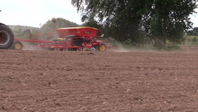 Tractor work in field on soil. Time of sowing. Planting crops stock video footage