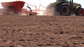 Tractor work in field. Time of sowing. Planting crops stock video